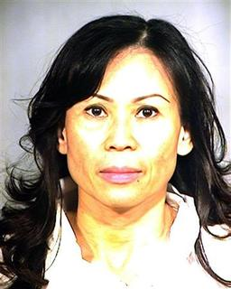 Catherine Kieu Becker in a police mugshot taken July 11, 2011. REUTERS/Garden Grove Police
