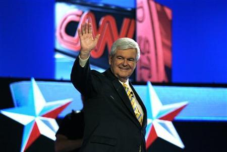 Former Speaker of the House of Representatives Newt Gingrich (R-GA) acknowledges supporters during a photo opportunity before the start of the first New Hampshire debate of the 2012 campaign at St Anselms College in Manchester, New Hampshire June 13, 2011. REUTERS/Joel Page