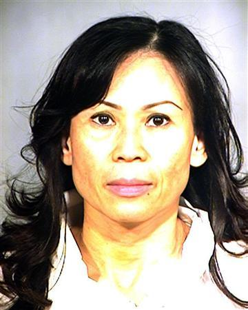 Catherine Kieu Becker, seen in a police mugshot taken July 11, 2011, has been arrested and charged with the crimes of aggravated mayhem, false imprisonment, and assault with a deadly weapon, administering a drug with intent to commit felony, poisoning, and spousal abuse after police responded to a home in Garden Grove, California and said that they found her husband tied to a bed and bleeding from his groin area. Police said in a news release issued July 12, 2011 that Becker had used an unknown type of poison and/or drug in her husband's food to make him sleepy, then tied him to a bed and as he awoke cut off his penis with a knife. REUTERS/Garden Grove Police/Handout