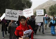 "<p>Afghan women protest against street harassment in Kabul July 14, 2011. In high heels and head scarves, a small band of Afghan women took to the streets of the country's capital Kabul on Thursday to protest harassment by men. The signs read, ""Street violence is illegal"" (in black), ""We will not be silent in the face of street harassment"" (in red) and ""To disgrace women is to disgrace humanity"" (in blue). REUTERS/Mohammad Ismail</p>"