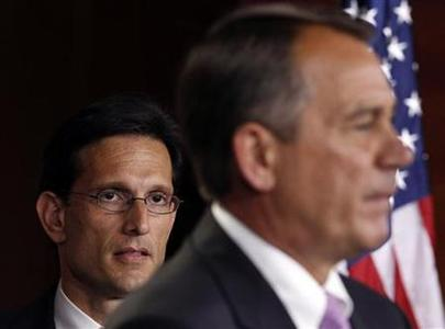 House Majority Leader Rep. Eric Cantor (L) listens to Speaker of the House John Boehner (R) discussing the Balanced Budget Amendment, which is scheduled to be considered on the floor of the House next week, at a news conference on Capitol Hill in Washington, July 14, 2011. REUTERS/Larry Downing