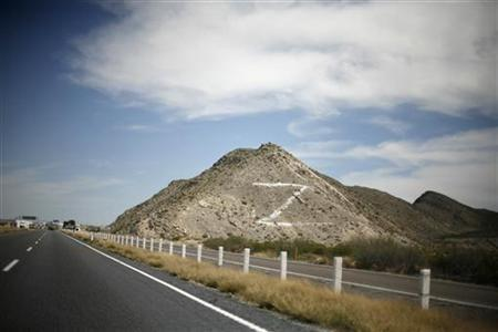 The letter ''Z'' is seen painted on a hill next to the toll booth at the freeway between Monterrey and Torreon, in the Mexican state of Coahuila March 13, 2010. The ''Z'' refers to the Zetas drug cartel. In just four years, Monterrey, a manufacturing city of 4 million people 140 miles (230 km) from the Texan border, has gone from being a model for developing economies to a symbol of Mexico's drug war chaos, sucked down into a dark spiral of gangland killings, violent crime and growing lawlessness. By engulfing Monterrey, home to some of Latin America's biggest companies and where annual income per capita is double the Mexican average at $17,000, the violence shows just how serious the security crisis has become in Mexico, the world's seventh-largest oil exporter and a major U.S. trade partner. REUTERS/Tomas Bravo