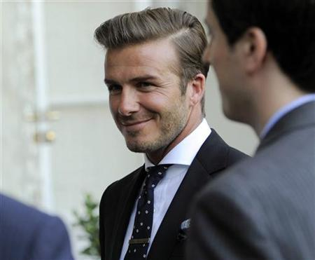 Soccer player David Beckham attends a private reception for Britain's Prince William and his wife Catherine, Duchess of Cambridge at the British Consul-General's residence in Los Angeles July 8, 2011. Prince William and his wife are on a royal visit to California from July 8 to July 10. REUTERS/Chris Pizzello/Pool