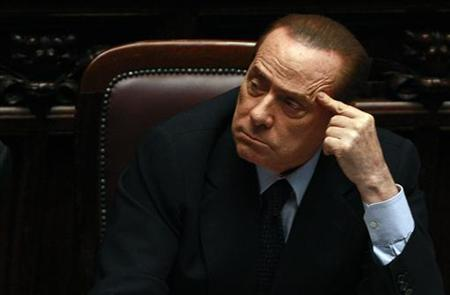 Italy's Prime Minister Silvio Berlusconi looks on during a debate in the upper house of Parliament in Rome July 15, 2011. REUTERS/Tony Gentile