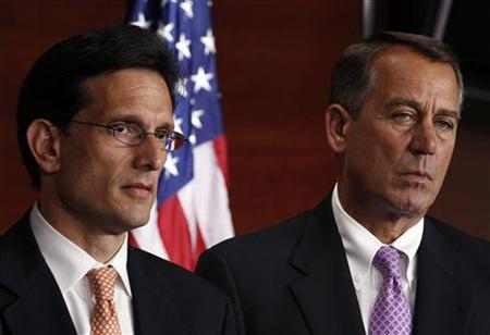 Speaker of the House John Boehner (R) and House Majority Leader Rep. Eric Cantor (L) listen to Republican House leaders discuss the Balanced Budget Amendment, which is scheduled to be considered on the floor of the House next week, at a news conference on Capitol Hill in Washington, July 14, 2011. REUTERS/Larry Downing