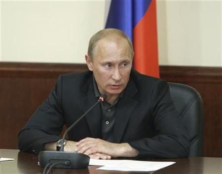 Russia's Prime Minister Vladimir Putin chairs a meeting after laying flowers in memory of victims of the tourist boat ''Bulgaria'', which sank on the Volga river, in Kazan July 14, 2011. REUTERS/Alexei Nikolsky/RIA Novosti/Pool