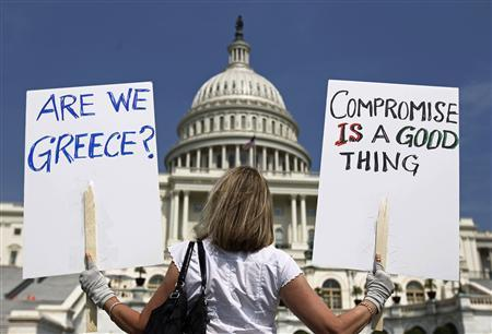 A demonstrator in front of the Capitol in Washington, July 18, 2011. REUTERS/Kevin Lamarque