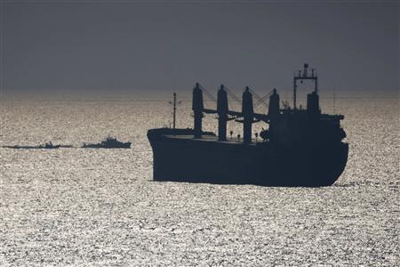 Israeli naval boats escort the ''Dignite-Al-Karama'' yacht (C) into the port of Ashdod, July 19, 2011. REUTERS/Amir Cohen