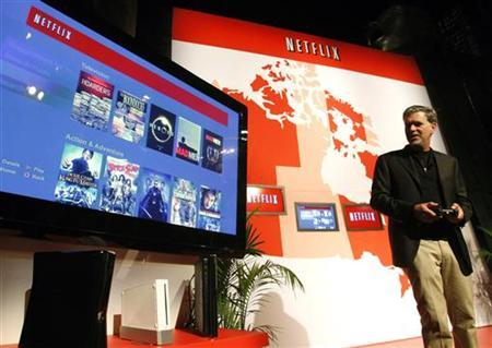 Netflix Chief Executive Officer Reed Hastings demonstrates how various gaming devices can be used to stream content during the launch of the Netflix streaming internet subscription service for movies and television shows to TVs and computers in Canada at a news conference in Toronto September 22, 2010. REUTERS/ Mike Cassese