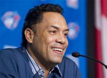 <p>Former Blue Jays player Roberto Alomar smiles as he speaks to the media after announcement of his induction into the Major League Baseball Hall of Fame, at Rogers Centre in Toronto January 5, 2011. REUTERS/Fred Thornhill</p>