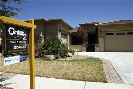 A real estate for sale sign is displayed outside a home in Chandler Heights, Arizona June 2, 2011. REUTERS/Joshua Lott