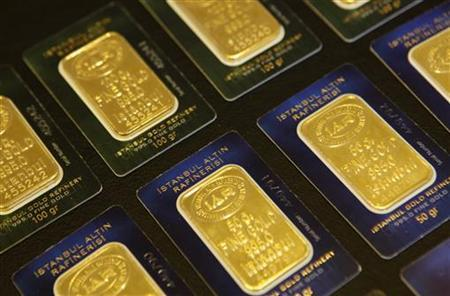 Bars of 50 and 100 gram fine gold are displayed at a branch of Istanbul Gold Refinery in Istanbul July 19, 2011. REUTERS/Murad Sezer
