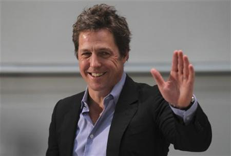 Hugh Grant at a promotional event for his movie ''Did You Hear About the Morgans?'' in Berlin, December 4, 2009. REUTERS/Tobias Schwarz