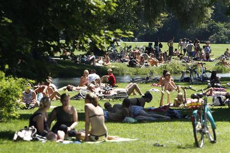 People relax in the sun at Munich's English Garten park in this June 28, 2011 file photo. REUTERS/Michaela Rehle/Files