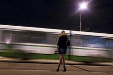 <p>A prostitute waits for clients on a street in the outskirts of Moscow April 25, 2009. REUTERS/Thomas Peter</p>