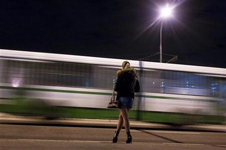 A prostitute waits for clients on a street in the outskirts of Moscow April 25, 2009. REUTERS/Thomas Peter