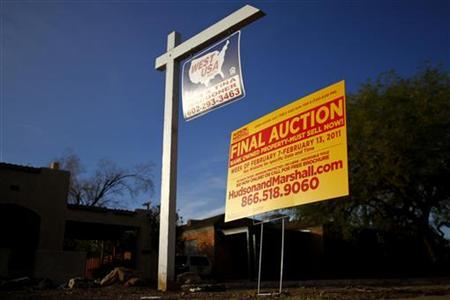 A realtor and bank-owned sign is displayed near a house for sale in Phoenix, Arizona, January 4, 2011. REUTERS/Joshua Lott