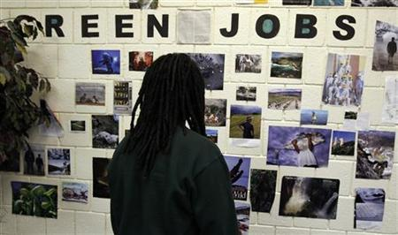 Student Brian Goode looks at pictures of green jobs on a wall at the Youth Opportunity (YO!) Academy and the Westside Youth Opportunity Community Center in Baltimore March 9, 2011. REUTERS/Kevin Lamarque