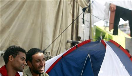 Egyptian protesters Adam El Rawy, 32, and Ahmed Abd El-fatah, who started on a hunger strike on July 14, are seen at their tent in Tahrir Square in Cairo July 20, 2011. REUTERS/Amr Abdallah Dalsh