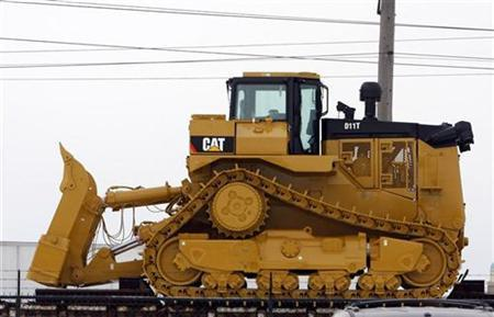 A bulldozer sits on a railcar outside the Caterpillar plant in Peoria, Illinois January 26, 2009. REUTERS/Frank Polich