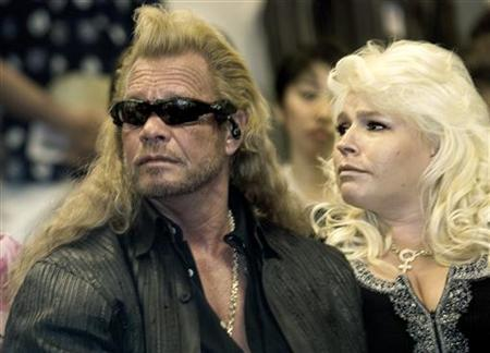 Duane 'Dog' Chapman (L) and his wife Beth Chapman listen to testimony before the International Affairs Committee of the Hawaii State Legislature in Honolulu, March 7, 2007, as he tries to gain support for his fight against extradition to Mexico. REUTERS/Lucy Pemoni