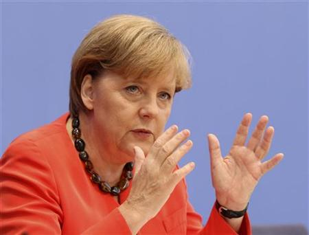 German Chancellor Angela Merkel addresses the media during a news conference in Berlin July 22, 2011. REUTERS/Fabrizio Bensch