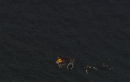 An aerial view shows people swimming in the water close to Utoeya island in this still image taken from video footage on July 22, 2011, after a shooting took place on the island at a meeting of the youth wing of Norway's ruling Labour Party. REUTERS/TV2 Norway via Reuters TV