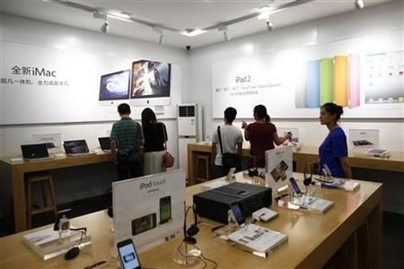 Customers and employees are seen inside a fake Apple Store in Kunming, Yunnan province July 22, 2011. REUTERS/Aly Song