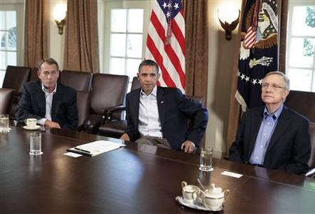 U.S. President Barack Obama (C) sit with House Speaker John Boehner (R-OH) (L) and Senate Majority Leader Harry Reid (D-NV) during a meeting about the debt limit at the White House in Washington July 23, 2011. REUTERS/Yuri Gripas
