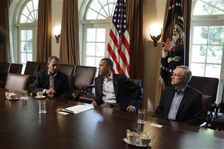 President Barack Obama (C) sits with House Speaker John Boehner (R-OH) (L) and Senate Majority Leader Harry Reid (D-NV) during a meeting about the debt limit at the White House in Washington July 23, 2011. REUTERS/Yuri Gripas