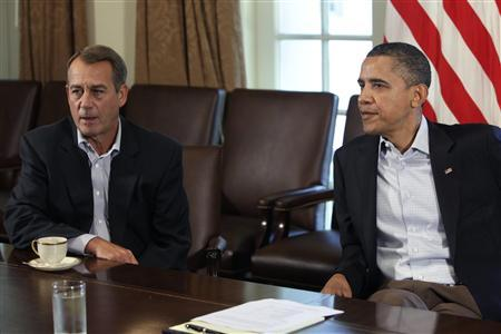 U.S. President Barack Obama (R) and House Speaker John Boehner (R-OH) sit during a meeting about the debt limit at the White House in Washington July 23, 2011. REUTERS/Yuri Gripas