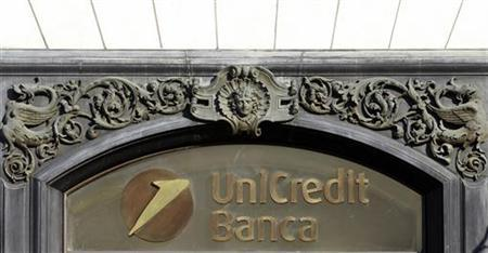 The Unicredit logo is seen downtown in Rome February 8, 2011. REUTERS/Alessandro Bianchi