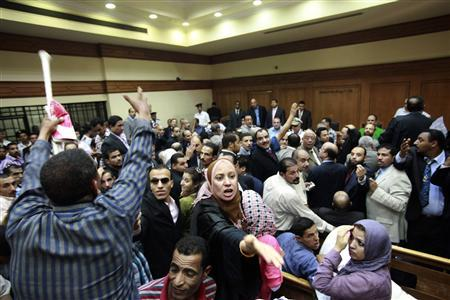 Demonstrators shout at the court house where Egypt's former interior minister would be tried, in New Cairo July 25, 2011. REUTERS/Asmaa Waguih