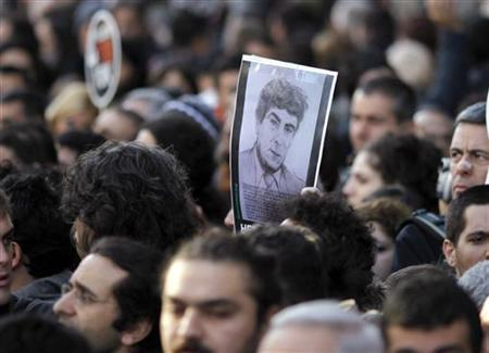 A portrait of Turkish Armenian newspaper editor Hrant Dink is seen during a demonstration to mark the fourth anniversary of his death, outside the office of the Agos newspaper in Istanbul, January 19, 2011. REUTERS/Osman Orsal