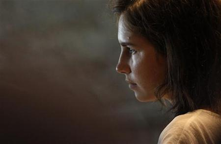 Amanda Knox, the U.S. student convicted of killing her British flatmate in Italy three years ago, attends a trial session in Perugia July 25, 2011. REUTERS/Alessandro Bianchi