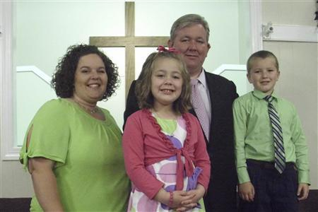 Family Baptist Church Pastor Joe Nelms (back), 35, of Lebanon, Tennessee, his wife Lisa, 34, and their children Eli, 8, and Emma, 6, are pictured in this 2011 Easter photograph released to Reuters on July 25, 2011. Nelms, pastor of Family Baptist Church in nearby Lebanon, Tennessee, borrowed a little bit from the film ''Talladega Nights'' and also from NASCAR legend Darrell Waltrip in his prayer before the weekend race. REUTERS/Joe Nelms/Family Baptist Church/Handout