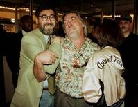 "<p>""National Lampoon's Animal House"" director John Landis (L) joins writer Chris Miller (C) and his wife Gloria Miller as she shows off an original jacket worn by the crew of the cult classic in this file photo.</p>"
