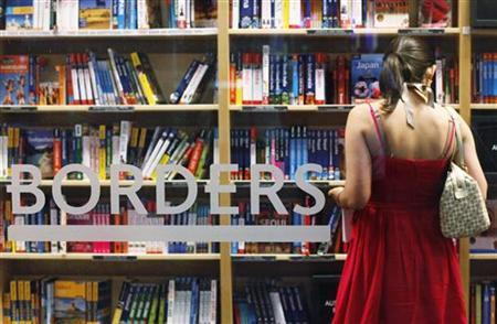 A woman shops inside a Borders bookstore in New York, July 19, 2011. REUTERS/Shannon Stapleton
