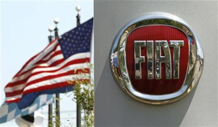 A U.S. flag flutters in the wind behind a Fiat logo at a car dealership in Alexandria, Virginia June 3, 2011. REUTERS/Kevin Lamarque
