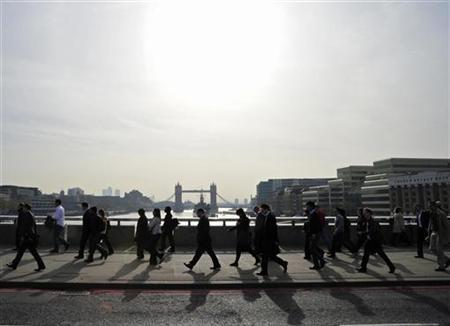 City workers cross London Bridge during the morning rush hour, in London April 11, 2011. REUTERS/Toby Melville