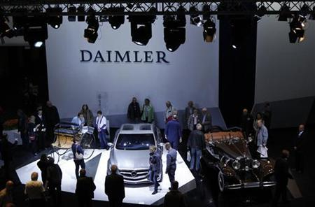 People look at historic and future Daimler cars at a Daimler annual shareholder meeting in Berlin, April 13, 2011. REUTERS/Thomas Peter