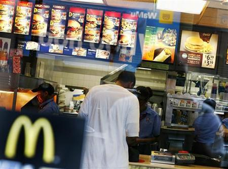 A man stands at the counter inside a McDonald's restaurant in Times Square in a file photo. REUTERS/Shannon Stapleton