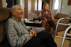 <p>Duane Michelson, 90, and his daughter Darla Shultz, 49, watch television at Shultz's home in Independence, Iowa, July 6, 2011. Shultz has recently taken on the responsibility of taking care of her father as his health has started to decline in an effort to keep him at home and out of a nursing home. REUTERS/Jessica Rinaldi</p>