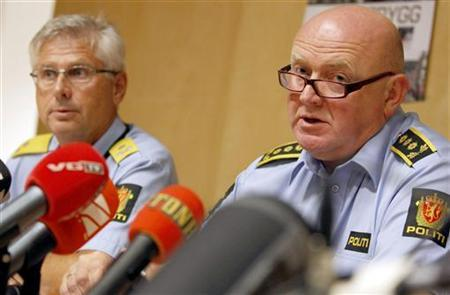 Acting Police Chief Sveinung Sponheim (L) and Police Chief of Staff Johan Fredriksen address a news conference at the police headquarters in Oslo July 26, 2011. Norway's justice minister on Tuesday hailed ''fantastic'' police work after Anders Behring Breivik killed at least 76 people, setting aside criticisms that police had reacted too slowly to a shooting massacre. REUTERS/Erlend Aas/Scanpix