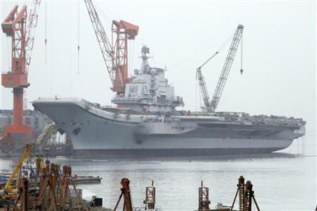 A vessel reported to be the Ukrainian-made aircraft carrier ''Varyag'', which China bought in the 1990s, is seen at a port in Dalian, Liaoning province April 17, 2011. REUTERS/Stringer