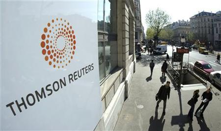 The plaque featuring the new logo for Thomson Reuters company adorns the facade of Paris offices on Boulevard Haussmann April 17, 2008. REUTERS/Jacky Naegelen