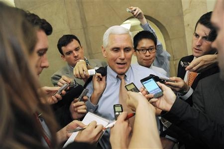 Representative Mike Pence (R-IN) (C) talks with reporters as he departs a meeting about debt ceiling legislation with fellow Republicans at the U.S. Capitol in Washington, July 28, 2011. REUTERS/Jonathan Ernst