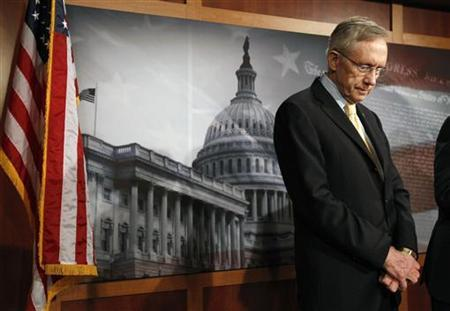 Senate Majority Leader Harry Reid looks down after talking about the budget in the Capitol in Washington April 7, 2011. REUTERS/Kevin Lamarque