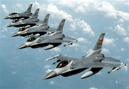 Five U.S. Air Force F-16 ''Fighting Falcon'' jets fly in echelon formation over the U.S. en route to an exercise in this undated file photograph. REUTERS/USAF/Staff Sgt. Greg L. Davis/Handout/Files