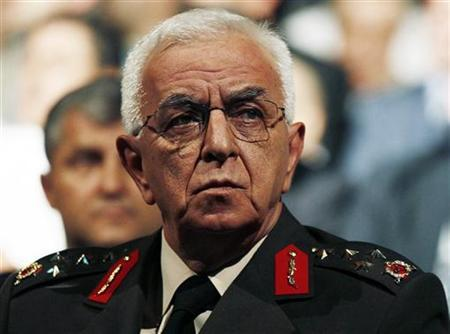 Turkey's Ground Forces Chief General Isik Kosaner attends a ceremony in Ankara, in this July 16, 2010 file picture. Kosaner, along with the heads of the ground, naval and air forces have resigned, broadcaster CNN Turk reported on July 29, 2011. REUTERS/Umit Bektas/Files